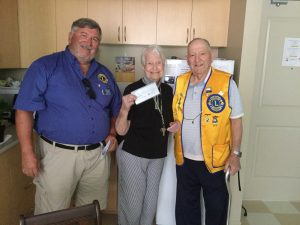 Lion George Laurencic, Betty Lehigh (winner of $500.00) of Cobourg and Lion Norm LeBlanc