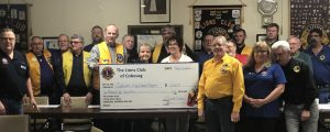 Proceeds from New Years Eve fundraiser being presented to Salvation Army Outreach program